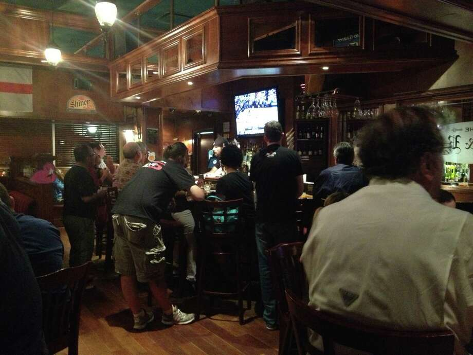Fans watch closely during the 2nd quarter at The Lion & Rose British Restaurant & Pub, 842 NW Loop 410. Photo: Elise Brunsvold / San Antonio Express-News