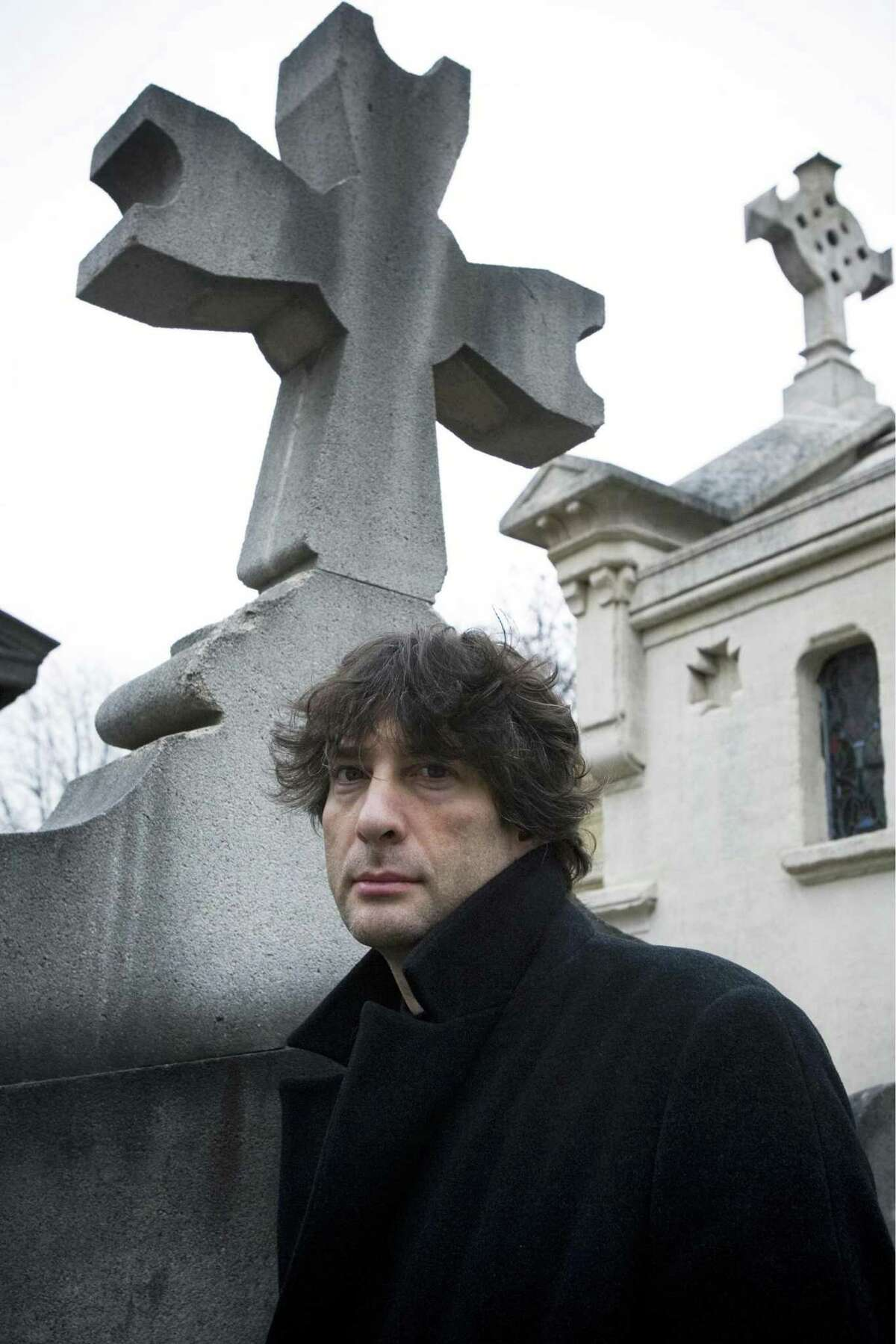 In this undated photo released by HarperCollins, Neil Gaiman, author of