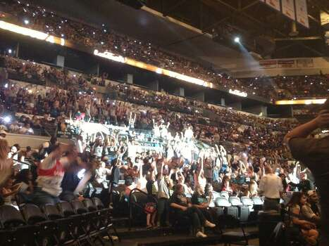 The wave is sweeping (or washing?) across the AT&T center. Photo: Michelle Casady / San Antonio Express-News