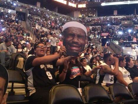 "Seem to be about double the number of ""sad LeBron"" cardboard heads dotting the crowd at the AT&T Center. Photo: Michelle Casady / San Antonio Express-News"
