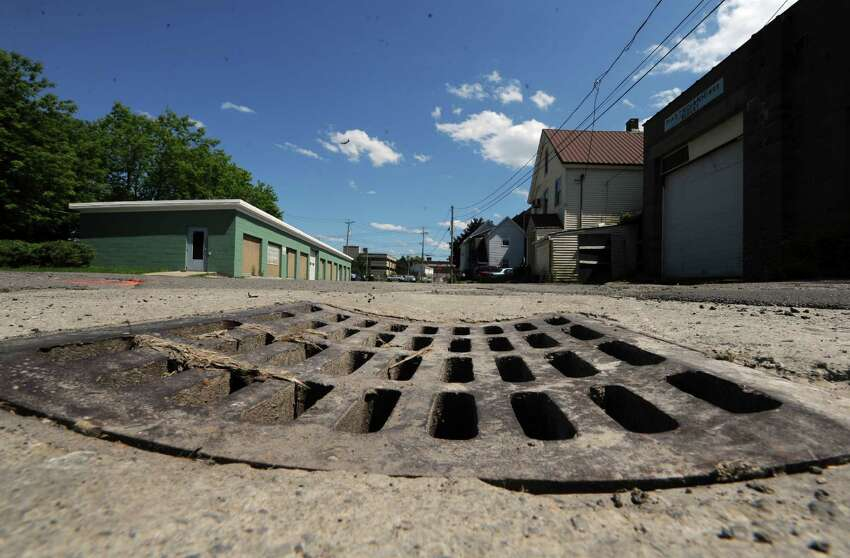 A sewer grate on Mohawk Avenue near Front Street on Thursday June 20, 2013 in Schenectady, N.Y. (Michael P. Farrell/Times Union)