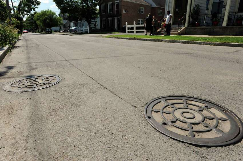 Sewer manhole cover on Front Street near Mohawk Avenue on Thursday June 20, 2013 in Schenectady, N.Y. (Michael P. Farrell/Times Union)