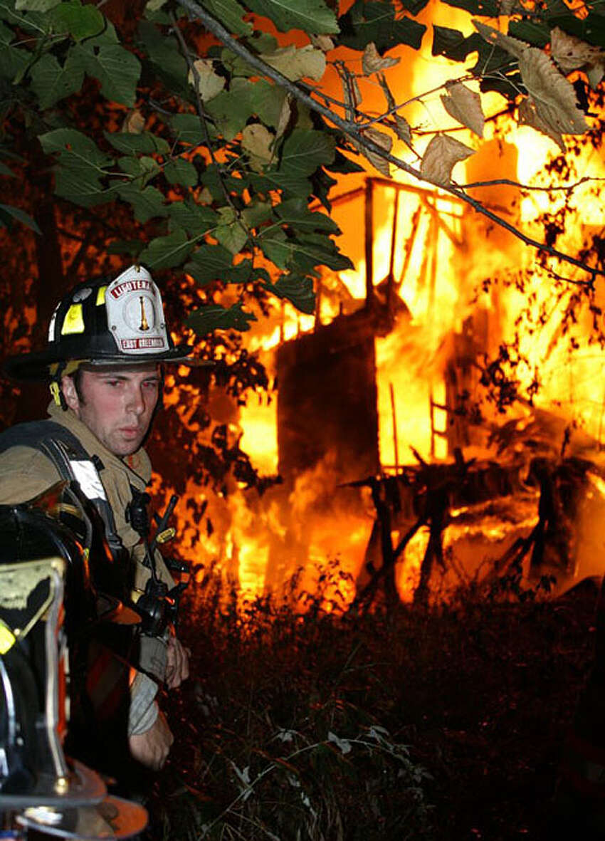 Firefighters battle a blaze which destroyed the 18th century Kospa Farmhouse in East Greenbush on Aug. 29, 2012. Four teenagers were charged with starting the fire. (Courtesy East Greenbush Police)