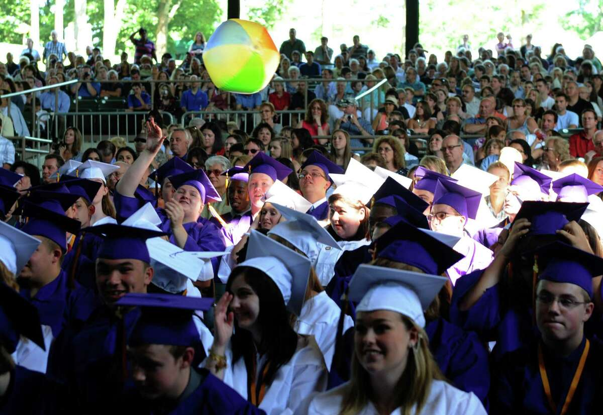 Graduates bat around a beach ball during Ballston Spa High School's graduation commencement at SPAC on Friday June 20, 2013 in Saratoga Springs, N.Y. (Michael P. Farrell/Times Union)
