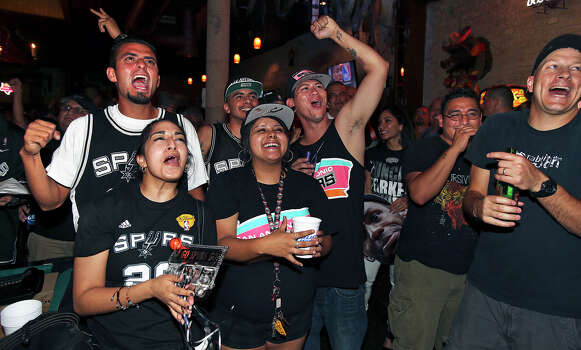 Spurs fans react to a lead change as they watch game 7 of the NBA finals at Moses Rose's Tavern  in downtown San Antonio .  June 20, 2013. Photo: Tom Reel, San Antonio Express-News