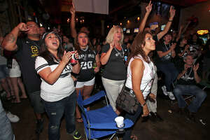 Spurs fans watch game 7 of the NBA finals at Moses Rose's Tavern  in downtown San Antonio .  June 20, 2013.