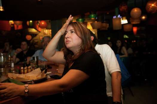 Cynthia and Andres Palma of Seattle watch the Spurs play in the NBA finals at Barriba Cantina on Thursday, June 20, 2013. The Palmas are in San Antonio house hunting. Photo: Abbey Oldham, San Antonio Express-News / © San Antonio Express-News
