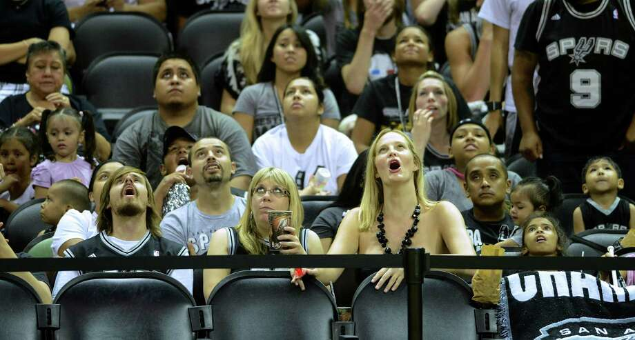 Spurs fans watching on a big screen in the AT&T Center seem concerned as the Miami Heat mount a lead on Thursday night, June 20, 2013. Photo: Billy Calzada, San Antonio Express-News / San Antonio Express-News