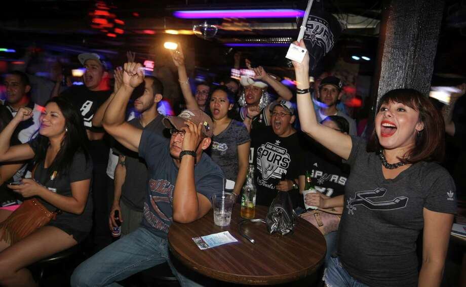 Lori Fuentes, right, and other San Antonio Spurs fans at the Basement Bar and Lounge yell after a Spurs score in the first half of the game on Thursday, June, 20, 2013. Photo: Bob Owen, San Antonio Express-News / ©2013 San Antonio Express-News