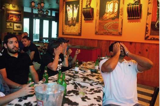 Pra Shan't (right) watches the Spurs play in the NBA finals at the County Line and Barriba Cantina upstairs room in downtown San Antonio on Thursday, June 20, 2013. 
