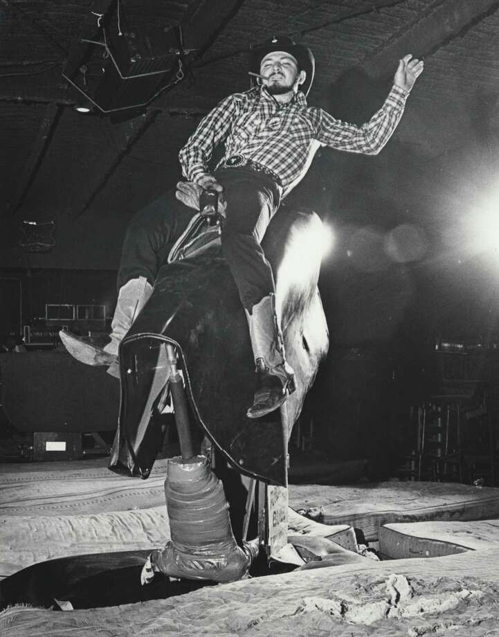 "Gilleyrat Gator Conley riding the bull at Gilley's Club in 1980.  Gator was featured in the movie ""Urban Cowboy"". Photo: Houston Chronicle / Houston Post Files"