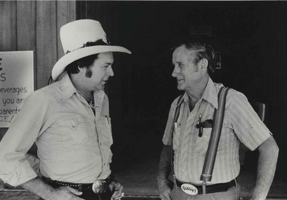 Mickey Gilley, left, handled the singing and Sherwood Cryer ran Gilley's when this photo was taken at the Pasadena club in 1980. Photo: Joel Draut, Houston Chronicle / Houston Post Files
