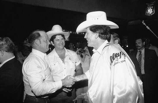 Presidential candidate Gary Hart is sized up by two patrons of Mickey Gilleyís club after the man on the left gave Hart his cowboy hat when the candidate made an impromptu visit to the famous Texas Honky Tonk in Pasadena, Sunday, April 30, 1984. Photo: R.J. Carson, ASSOCIATED PRESS / AP1984