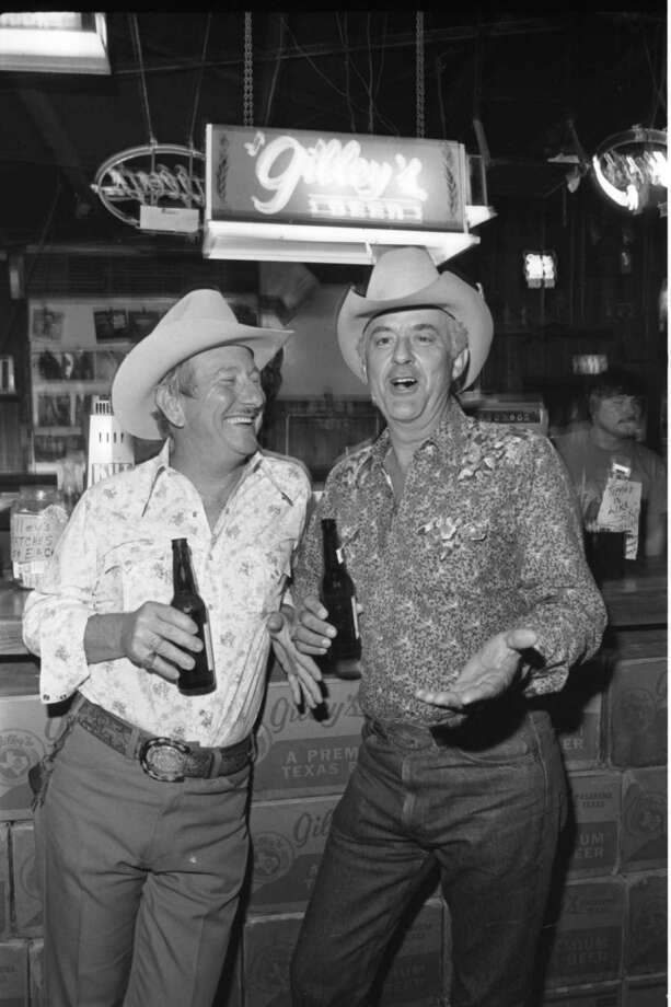 Ronald Labiolais and Steve Broussard at Gilley's Club in Pasadena, Texas. Photo: Ben DeSoto, Houston Chronicle / The Houston Chronicle
