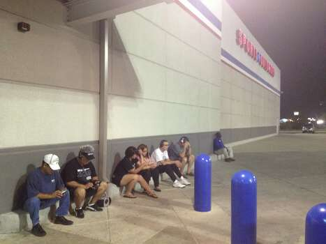 Spurs fans look despondent as they wait outside Academy Sports and Outdoors hoping for a Spurs Game 7 win and championship gear. Photo: Elise Brunsvold / San Antonio Express-News