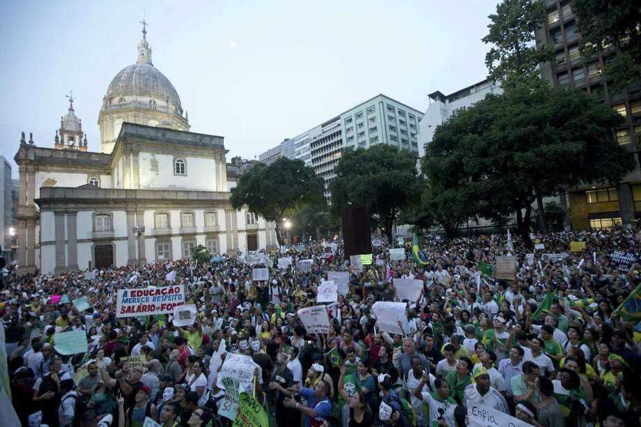 The peaceful demonstration behind the Candelaria church in Rio de Janeiro takes on a carnivallike atmosphere. Photo: Silvia Izquierdo / Associated Press
