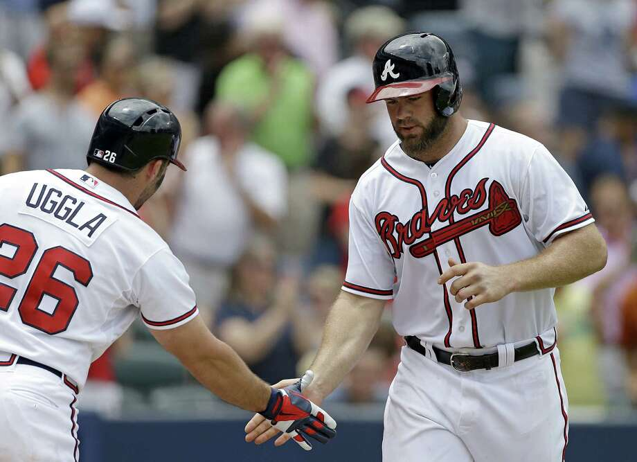 Evan Gattis, the National League rookie of the month in April and May, was headed to Texas A&M but didn't make it to campus. Photo: David Goldman / Associated Press