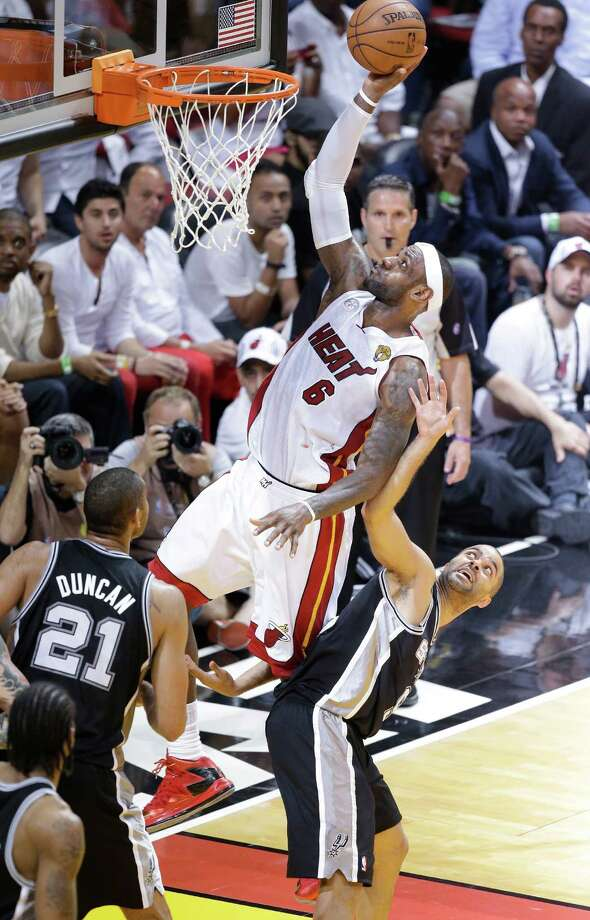 The San Antonio Spurs' Tony Parker (9) moves out of the way pf Miami Heat's LeBron James (6) during the first half in Game 7 of the NBA basketball championships, Thursday, June 20, 2013, in Miami. (AP Photo/Wilfredo Lee) Photo: Wilfredo Lee