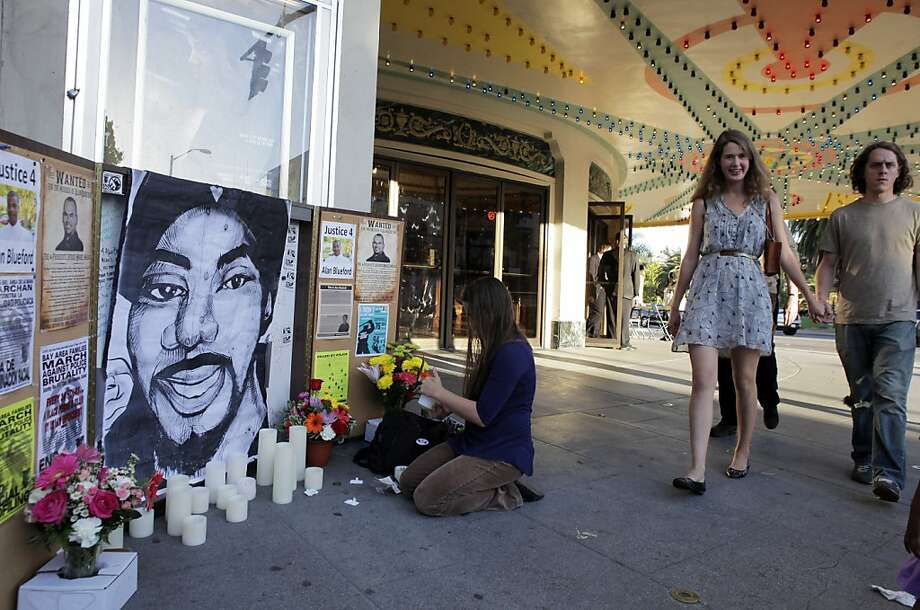 "Emily Loftis lights candles at a memorial for Oscar Grant at the Grand Lake Theater at a screening of ""Fruitvale Station."" Photo: Carlos Avila Gonzalez, The Chronicle"