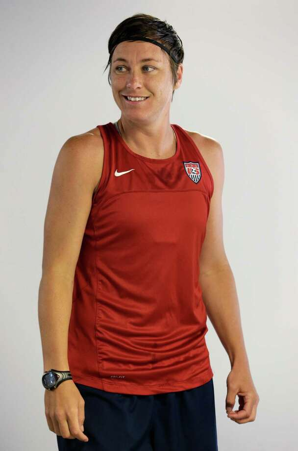 United States soccer player Abby Wambach walks out of the locker room before a workout at Red Bull Arena, Wednesday, June 19, 2013, in Harrison, N.J. Wambach is three goals from becoming the team's all time scoring leader. The U.S. will play against South Korea in an international soccer friendly on Thursday. (AP Photo/Julio Cortez) Photo: Julio Cortez