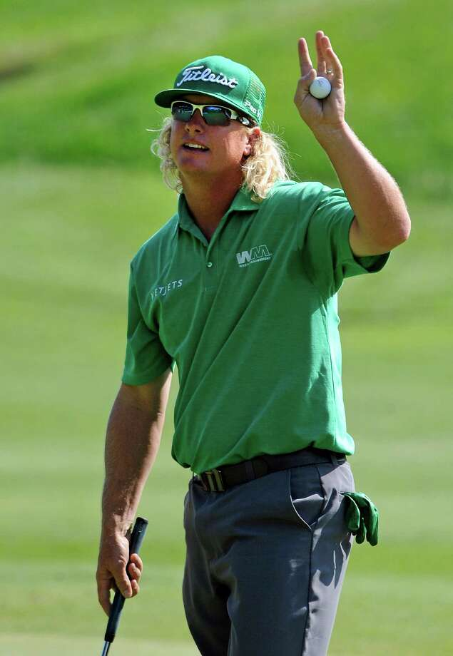 Charley Hoffman waves to the crowd after a birdie on the 18th hole during the first round of the Travelers Championship golf tournament in Cromwell, Conn., Thursday, June 20, 2013. (AP Photo/Fred Beckham) Photo: Fred Beckham