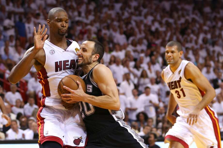 Manu Ginobili of the drives on Chris Bosh. Photo: Mike Ehrmann, Getty Images