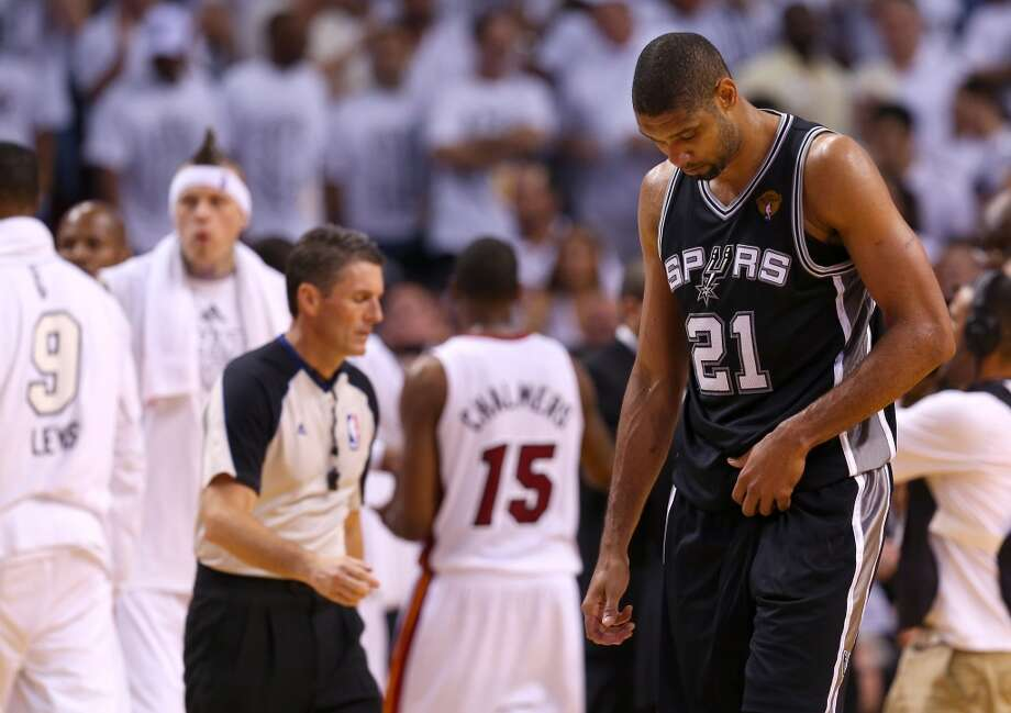 Tim Duncan walks to the bench late in the fourth quarter. Photo: Mike Ehrmann, Getty Images