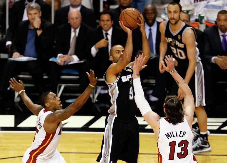 MIAMI, FL - JUNE 20:  Tony Parker #9 of the San Antonio Spurs shoots the ball over Mike Miller #13 of the Miami Heat in the first quarter during Game Seven of the 2013 NBA Finals at AmericanAirlines Arena on June 20, 2013 in Miami, Florida. NOTE TO USER: User expressly acknowledges and agrees that, by downloading and or using this photograph, User is consenting to the terms and conditions of the Getty Images License Agreement.  (Photo by Kevin C. Cox/Getty Images) Photo: Kevin C. Cox