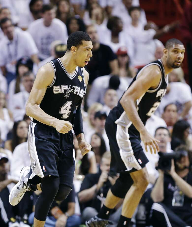 Danny Green and Tim Duncan react. Photo: Lynne Sladky, Associated Press