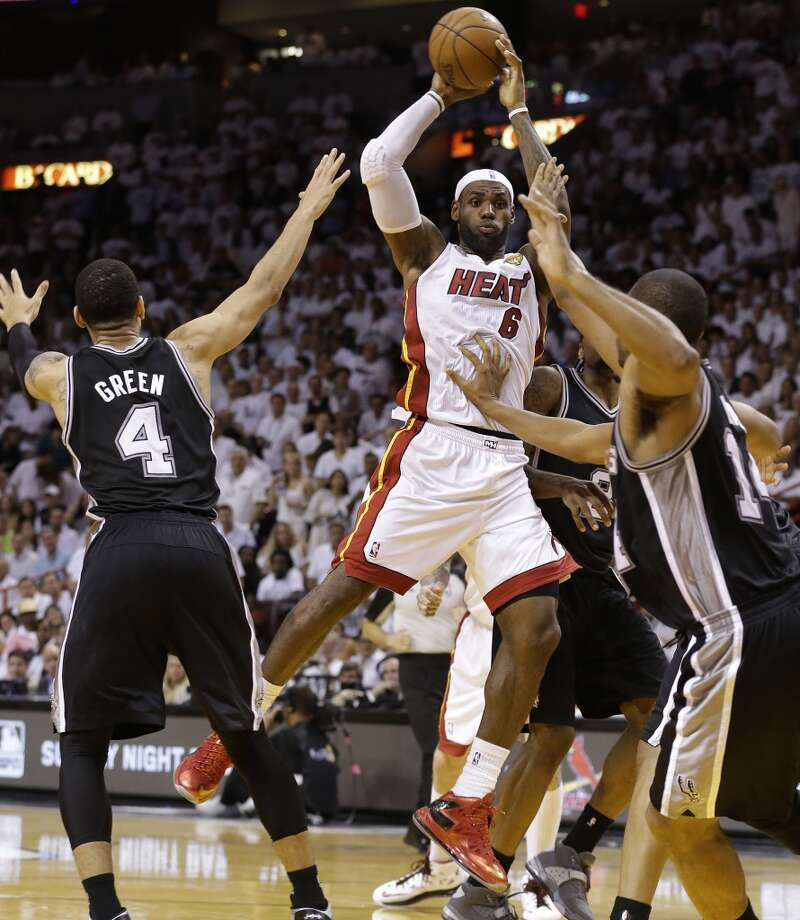 The Miami Heat's LeBron James shoots against Danny Green. Photo: Lynne Sladky, Associated Press
