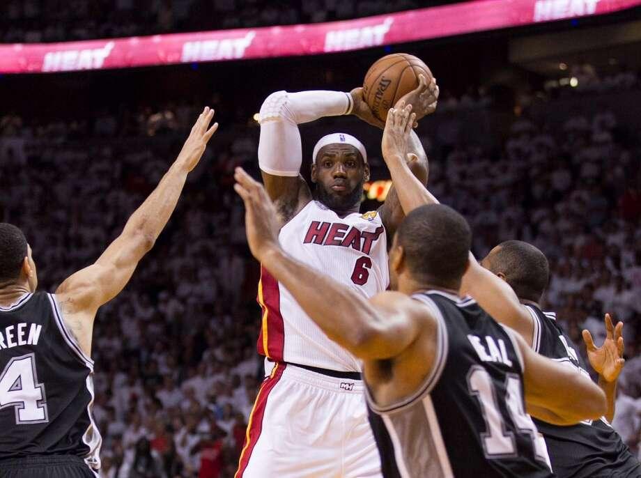 LeBron James looks for an open teammate. Photo: Allen Eyestone, McClatchy-Tribune News Service