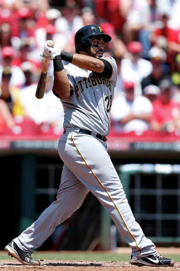 CINCINNATI, OH - JUNE 20: Pedro Alvarez #24 of the Pittsburgh Pirates singles to drive in a run in the third inning against the Cincinnati Reds during the game at Great American Ball Park on June 20, 2013 in Cincinnati, Ohio. (Photo by Joe Robbins/Getty Images) Photo: Joe Robbins