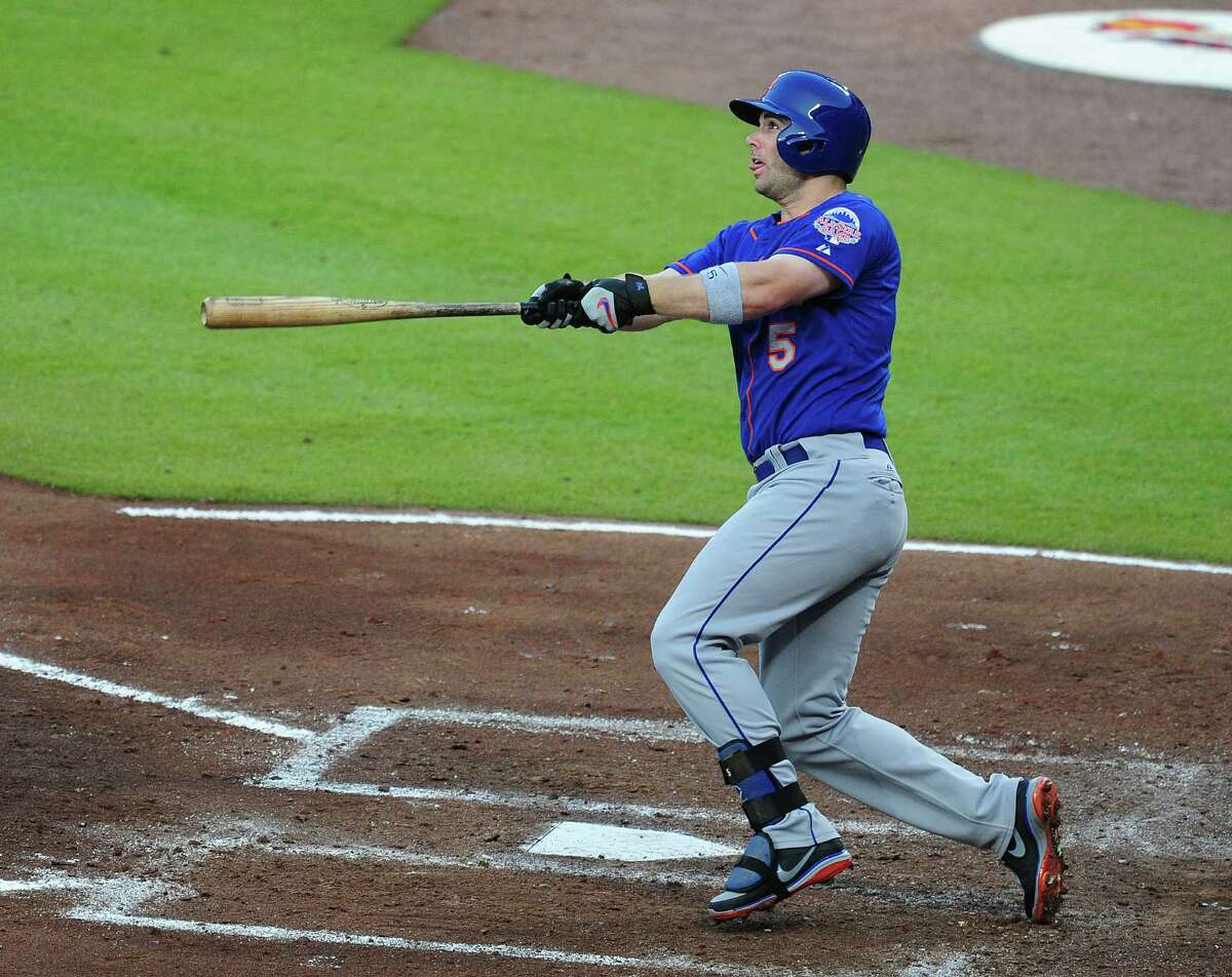 ATLANTA, GA - JUNE 20: David Wright #5 of the New York Mets hits his second home run of the game during the fourth inning against the Atlanta Braves at Turner Field on June 20, 2013 in Atlanta, Georgia. (Photo by Scott Cunningham/Getty Images)