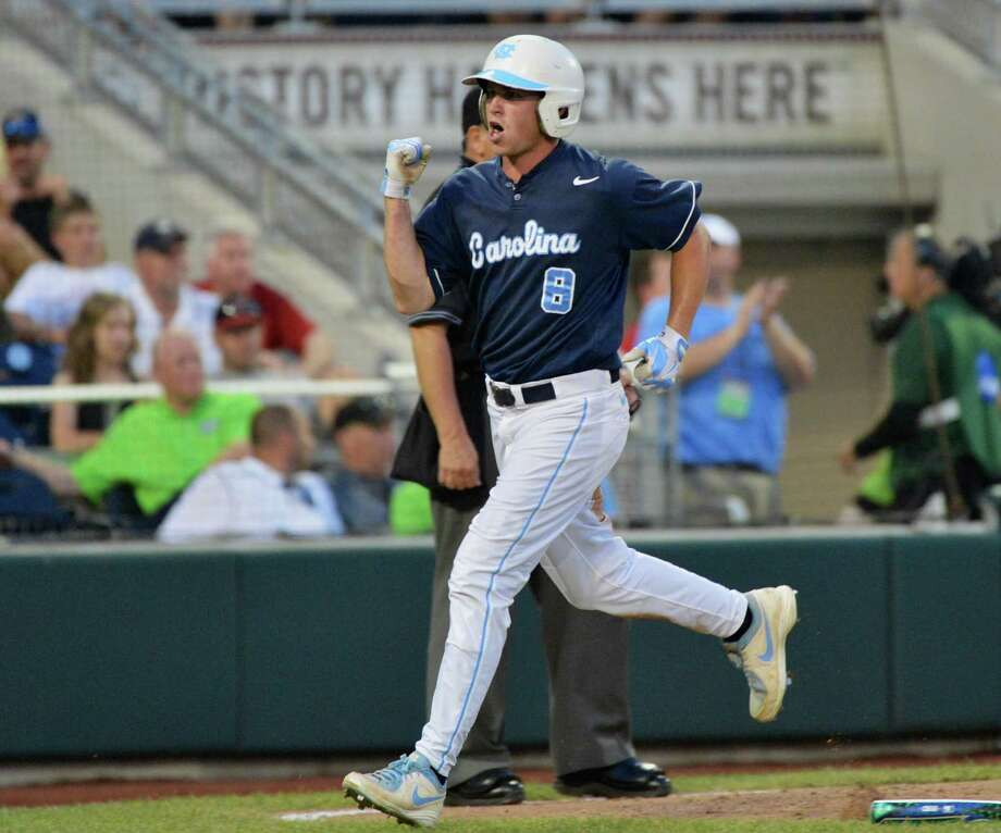 North Carolina's Parks Jordan celebrates after scoring against North Carolina State on a single by Colin Moran in the fifth inning of an NCAA College World Series elimination baseball game in Omaha, Neb., Thursday, June 20, 2013. (AP Photo/Ted Kirk) Photo: Ted Kirk