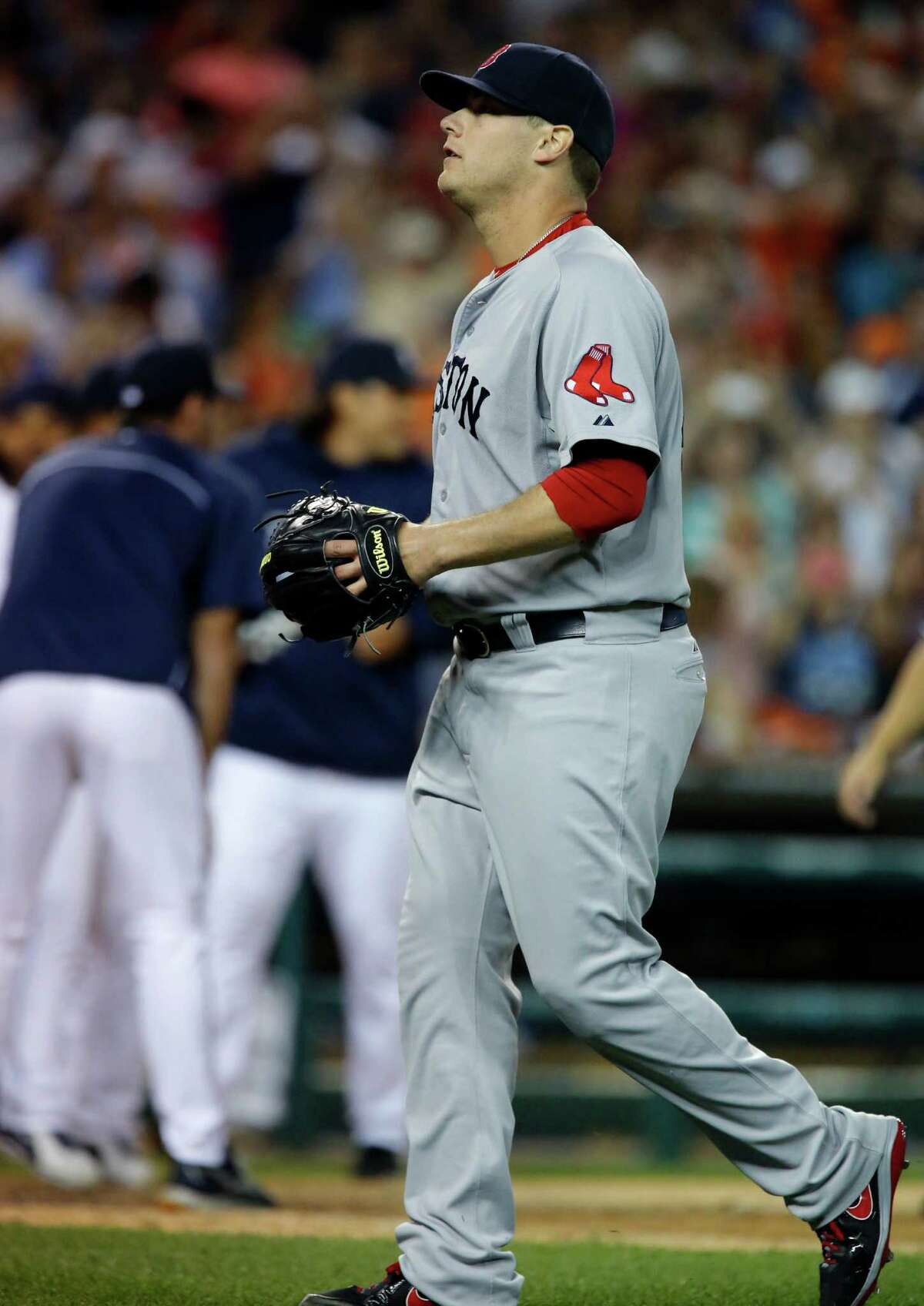 DETROIT, MI - JUNE 20: Closer Andrew Bailey #40 of the Boston Red Sox walks off the field after giving up a two-run home run to Jhonny Peralta of the Detroit Tigers in the ninth inning to give the Tigers a 4-3 win at Comerica Park on June 20, 2013 in Detroit, Michigan. (Photo by Duane Burleson/Getty Images)