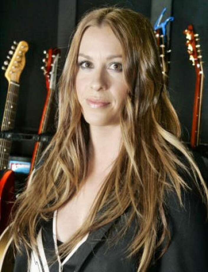"""Alanis Morissette and (Mario """"Souleye"""" Treadway)Kid's name: Ever Imre"""