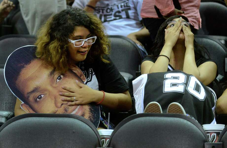 Caitlyn Sada, left, and Michelle Paredes are saddened by the Spurs loss to the Miami Heat in the NBA Finals Game 7. They watched the game on a big screen at the AT&T Center, the  Spurs home court, on Thursday night, June 20, 2013. Photo: Billy Calzada, San Antonio Express-News / San Antonio Express-News