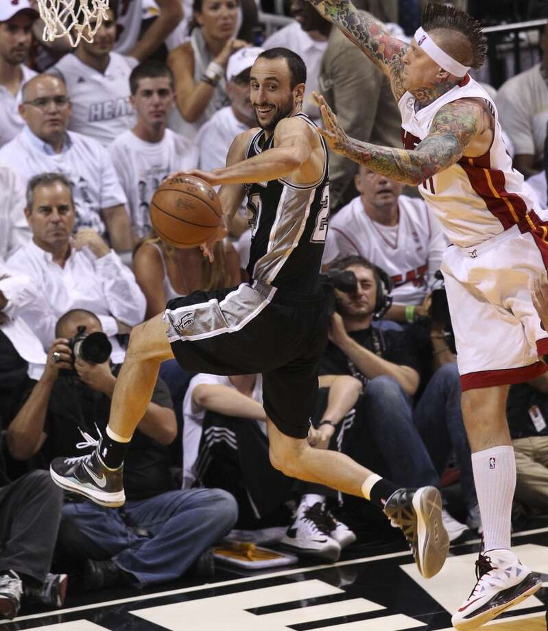 San Antonio Spurs' Manu Ginobili dishes out from under the net while under pressure from Miami Heat's Chris Andersen during the first half of Game 7 of the NBA Finals at American Airlines Arena on Thursday, June 20, 2013 in Miami. (Kin Man HuiSan Antonio Express-News) Photo: Kin Man Hui, San Antonio Express-News