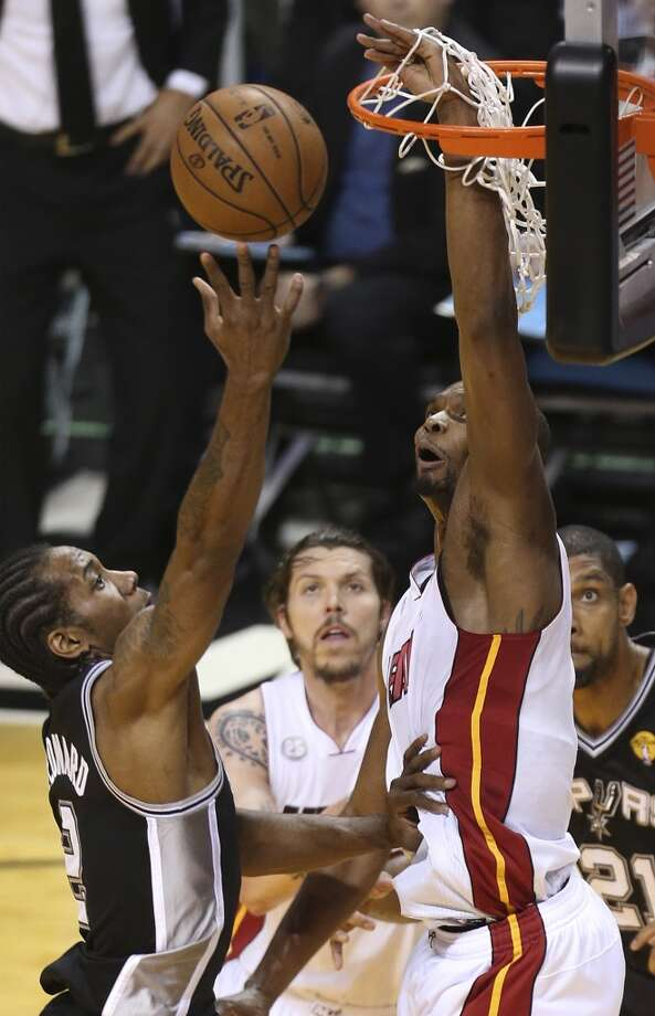=V1= gets his hand in the net while trying to defend San Antonio Spurs' Kawhi Leonard during the first half of Game 7 of the NBA Finals at American Airlines Arena on Thursday, June 20, 2013 in Miami. (Jerry Lara/San Antonio Express-News) Photo: Jerry Lara, San Antonio Express-News