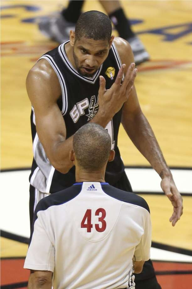 San Antonio Spurs' Tim Duncan argues a call with referee Dan Crawford during the first half of Game 7 of the NBA Finals at American Airlines Arena on Thursday, June 20, 2013 in Miami. (Jerry Lara/San Antonio Express-News) Photo: Jerry Lara, San Antonio Express-News