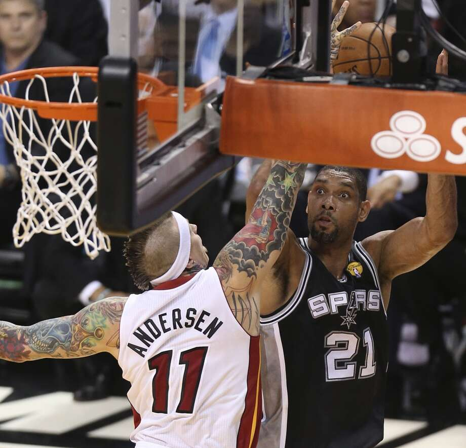San Antonio Spurs' Tim Duncan shoots over Miami Heat's Chris Andersen during the first half of Game 7 of the NBA Finals at American Airlines Arena on Thursday, June 20, 2013 in Miami. (Jerry Lara/San Antonio Express-News) Photo: Jerry Lara, San Antonio Express-News