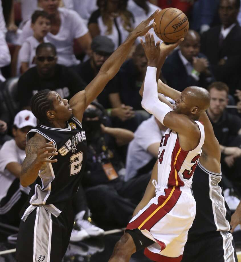 San Antonio Spurs' Kawhi Leonard tries to block a shot by Miami Heat's Ray Allen during the first half of Game 7 of the NBA Finals at American Airlines Arena on Thursday, June 20, 2013 in Miami. (Jerry Lara/San Antonio Express-News) Photo: Jerry Lara, San Antonio Express-News