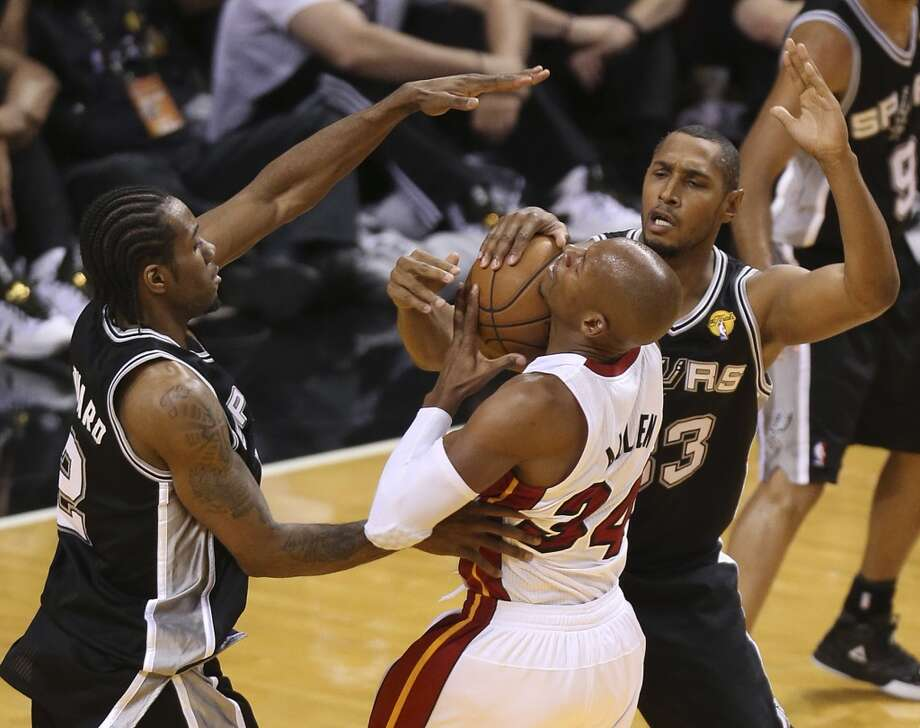 Miami Heat's Ray Allen runs into the defense of San Antonio Spurs' Kawhi Leonard and Boris Diaw during the first half of Game 7 of the NBA Finals at American Airlines Arena on Thursday, June 20, 2013 in Miami. (Jerry Lara/San Antonio Express-News) Photo: Jerry Lara, San Antonio Express-News