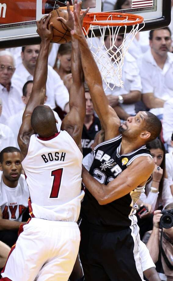 San Antonio Spurs' Tim Duncan gets a hand on a shot by Miami Heat's Chris Bosh during the first half of Game 7 of the NBA Finals at American Airlines Arena on Thursday, June 20, 2013 in Miami. (Jerry Lara/San Antonio Express-News) Photo: Jerry Lara, San Antonio Express-News