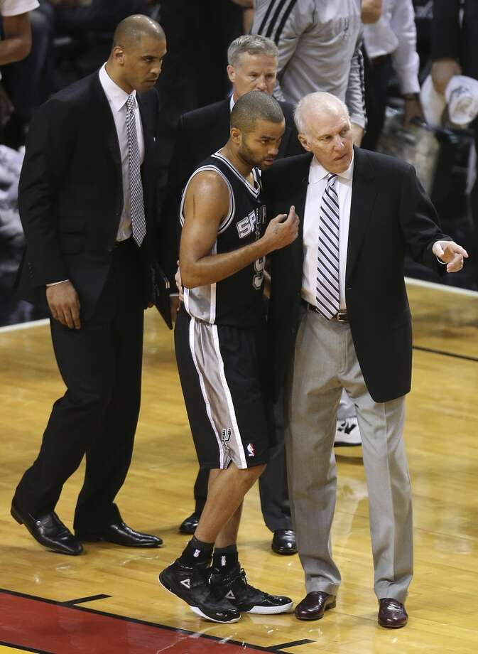 San Antonio Spurs head coach Gregg Popovich talks to Tony Parker during the first half of Game 7 of the NBA Finals at American Airlines Arena on Thursday, June 20, 2013 in Miami. (Jerry Lara/San Antonio Express-News) Photo: Jerry Lara, San Antonio Express-News