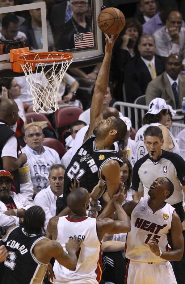 San Antonio Spurs' Tim Duncan goes to the rim while under pressure from Miami Heat's Chris Bosh and Mario Chalmers during the first half of Game 7 of the NBA Finals at American Airlines Arena on Thursday, June 20, 2013 in Miami. (Kin Man HuiSan Antonio Express-News) Photo: Kin Man Hui, San Antonio Express-News