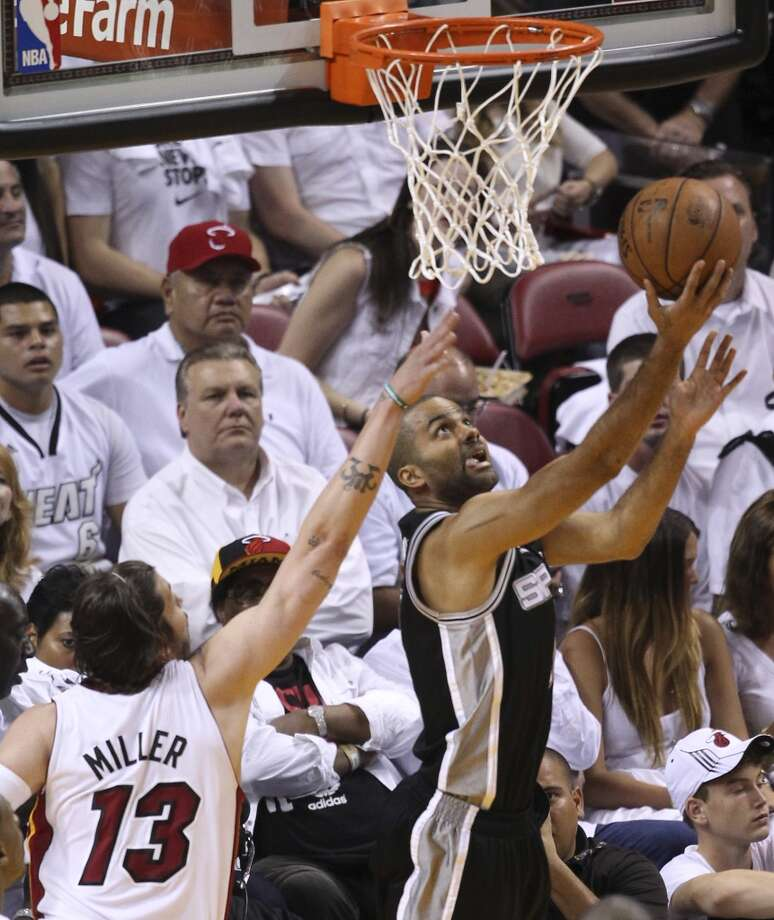 =s9- shoots from under the net while being defended by Miami Heat's Mike Miller during the first half of Game 7 of the NBA Finals at American Airlines Arena on Thursday, June 20, 2013 in Miami. (Kin Man HuiSan Antonio Express-News) Photo: Kin Man Hui, San Antonio Express-News