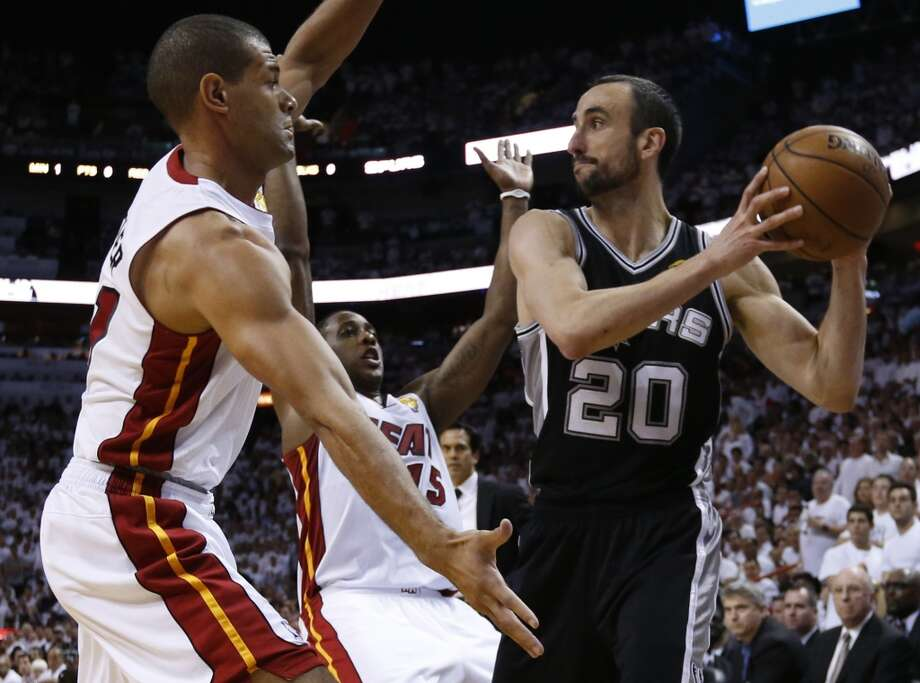 Miami Heat's Shane Battier and Mario Chalmers try to block San Antonio Spurs' Manu Ginobili into a corner during the first half of Game 7 of the 2013 NBA Finals Thursday, June 20, 2013 at American Airlines Arena in Miami. (Edward A. Ornelas/San Antonio Express-News) Photo: Edward A. Ornelas, San Antonio Express-News