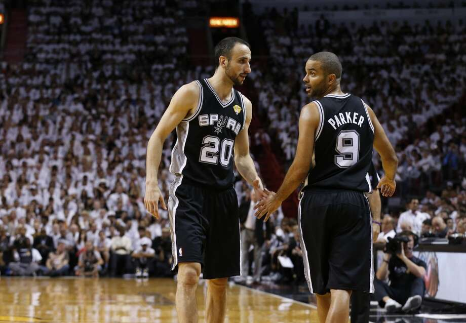 San Antonio Spurs' Manu Ginobili and Tony Parker slap hands during the first half of Game 7 of the 2013 NBA Finals Thursday, June 20, 2013 at American Airlines Arena in Miami. (Edward A. Ornelas/San Antonio Express-News) Photo: Edward A. Ornelas, San Antonio Express-News