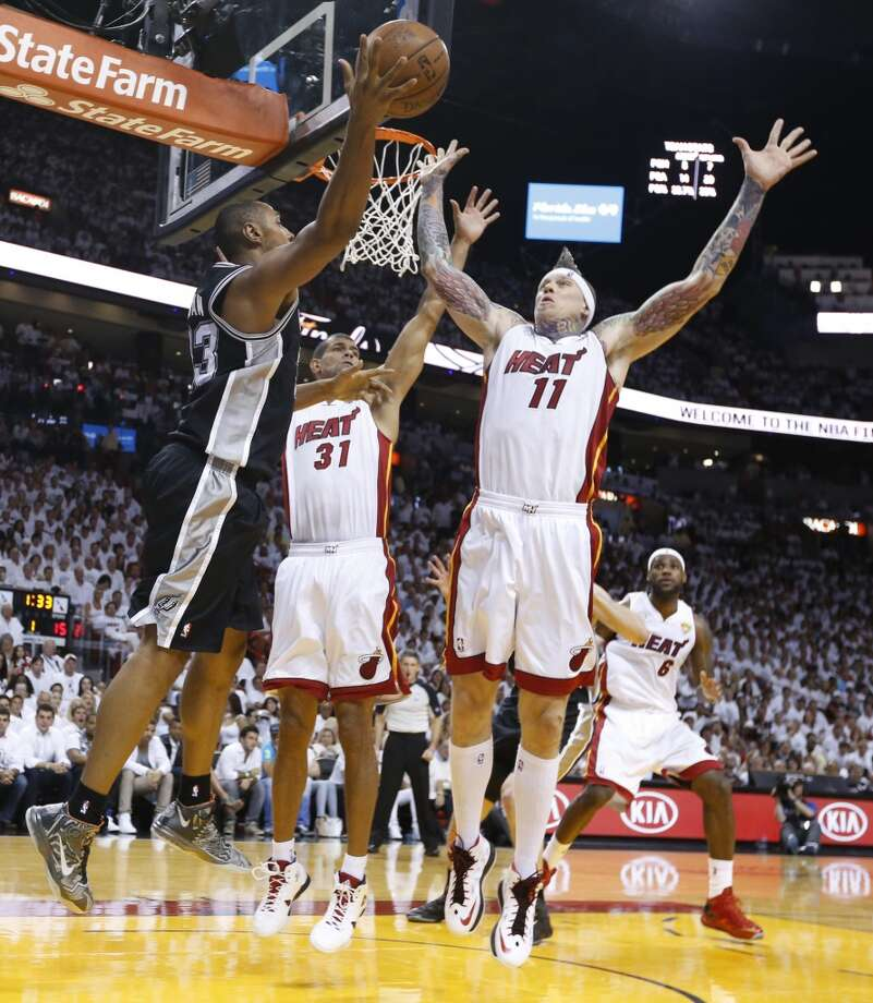 San Antonio Spurs' Boris Diaw passes around Miami Heat's Shane Battier and Chris Andersen during the first half of Game 7 of the 2013 NBA Finals Thursday, June 20, 2013 at American Airlines Arena in Miami. (Edward A. Ornelas/San Antonio Express-News) Photo: Edward A. Ornelas, San Antonio Express-News